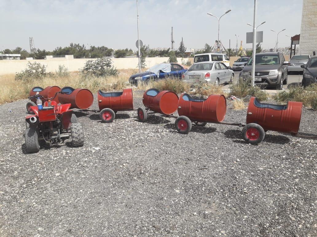 """الأمن يضبط """"قطار البراميل"""" في مخيم شنلر قرب الرصيفة/فيديو"""