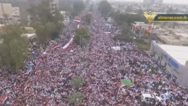 بغداد تعج بمظاهرة مليونية ترفع الاعلام وترتدي الاكفان وتطالب بخروج القوات الأمريكية من العراق/ فيديو
